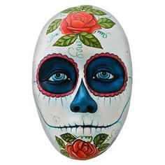 NEW!! Hand-painted in Jalisco, Mexico, these beautiful ceramic masks are evident of deft hands. Each is striking in its detail and design. This Day of the Dead mask captivates the eye and lends a touch of traditional Mexican decor to your home. This mask will add color and character to any wall.