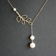 Mother / Bridesmaid gift:    Delicate lariat necklace white pearl and leaf branch - 14K GOLD FILLED - wedding jewelry bride bridesmaid gift for mom mothers day. $31.00, via Etsy.