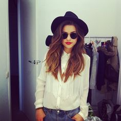 white blouse + black hat.
