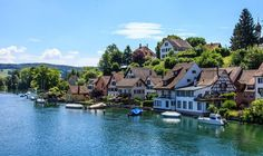 Spectacular mountain vistas, flower-lined nature paths, and picturesque historic centres make these 10 idyllic Swiss towns worth a visit. Rhine Falls Switzerland, Switzerland Summer, Switzerland Vacation, Visit Switzerland, Zermatt, Lugano, Beautiful Places, Most Beautiful, Beautiful Scenery