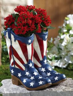 Give ordinary plant displays the boot and show off your green thumb with this star-spangled planter. Inspired by authentic cowboy footwear, this fun container holds houseplants, cut- or artificial flower arrangements.
