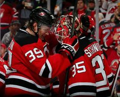 NEWARK, NJ - FEBRUARY 09: Seth Helgeson #39 of the New Jersey Devils celebrates the win with teammate Cory Schneider #35 after the win over the Edmonton Oilers on February 9, 2016 at Prudential Center in Newark, New Jersey.The New Jersey Devils defeated the Edmonton Oilers 2-1. (Photo by Elsa/Getty Images)