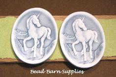 Plastic Unicorn Cameos  White on Blue  40x3mm by beadbarnsupplies, $2.00