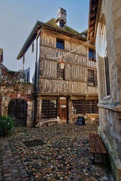 Street in Honfleur, Normandie, France ... beautiful old cobblestones and pavers....