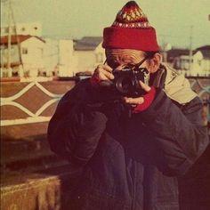 Takuma Nakahira with a Canon F-1 camera.