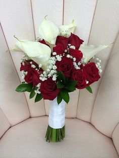 Rose and Calla Lily #Bouquet Price: $100.00 complementary mix of roses and large calla lilies accented with baby's breath.