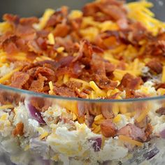 Loaded Baked Potato Salad 8 medium Russet Potatoes 1 cup sour cream 1/2 cup mayonnaise 1 package of bacon, cooked and crumbled 1 small onion, chopped Chives, to taste 1 1/2 cups shredded cheddar cheese Salt and Pepper to taste