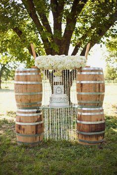 rustic country vinatge wine barrel wedding cake backdrop / http://www.himisspuff.com/rustic-country-wine-barrel-wedding-ideas/