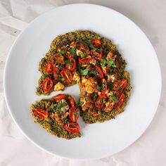 CHICKPEA QUINOA CHARD PIZZA TOPPED WITH ROASTED CAULIFLOWER AND GRAPE TOMATOES