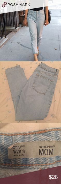 """Light wash mom jeans Topshop mom jeans that are tapered and go with anything ! Tag says 28"""" but it fits more like a 26-27"""" because the denim is extremely firm and high quality . I have a 28""""-29"""" waist and was able to wear them but couldn't breathe when sitting down ! No flaws or stains and this was reposhed . Used original owners pics . Topshop Pants Ankle & Cropped"""