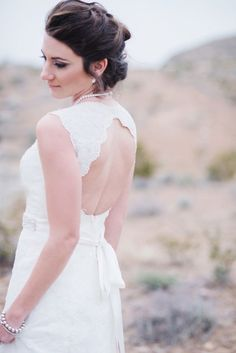 Classic lace wedding dress with a keyhole back | Photo by Rae Marshall