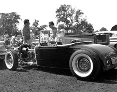Features 1950's period correct hot rods. - THE H.A.M.B.