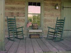 simple, primitive front porch with rockers
