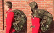 Tactical Pack Cover With Rain Hood - It is a pack cover made from the same material as our poncho, that fastens around your pack with drawstring and a buckled elastic strap to give it a waterproof camouflage cover. But as a bonus it has a hood and shoulder cape that protects you in rain that isn't enough for a full poncho.