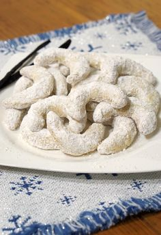 Crisp and buttery with a nutty almond flavor this recipe for delicate Vanillekipferl or Austrian Vanilla Crescent Cookies creates cookies that look pretty on a platter and are sure to be a hit at your holiday party. Christmas Desserts, Christmas Baking, Christmas Cookies, Christmas Biscuits, Christmas Traditions, Christmas Recipes, Gingerbread Cookies, Austrian Recipes, German Recipes