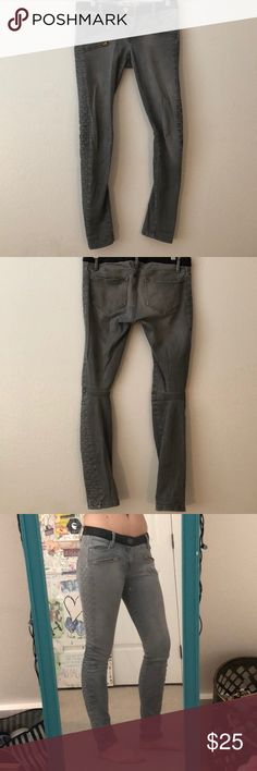 Grey Moto jeans Grey skinny Moto jeans with red zippers on the top and a leather waist band! The criss-cross lining down the sides gives them a little extra bling! Other then that they are very comfortable and always stylish! etienne marcel Jeans Skinny