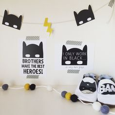 "This printable garland comes with 3 different elements in a range of colours so you can create the perfect paper garland for your space - Cowl Masks, Lightning Bolts and Masks! Love it next to our 'Brothers are the best heroes"" and ""I only work in black"" postcards, Batman felt ball garland from @sausage.and.missus and adorable shoes from @inchblue!"