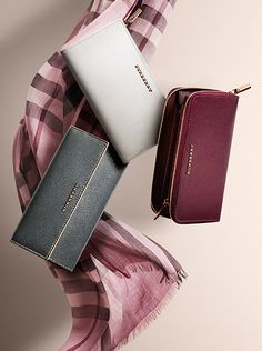 Patent leather wallets and silk check scarves in runway-inspired shades from Burberry