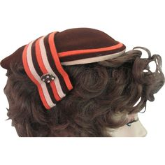 1940s Hat Fall Delta Stripes. Chocolate brown, orange and tan stripes make us this wonderful 1940s hat.  It has  a decoration of beads as shown on the