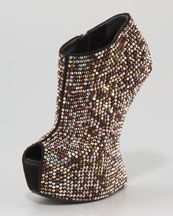 Gee, I think this is such an odd looking bootie no? No-Heel Platform Bootie from Giuseppe Zanotti.