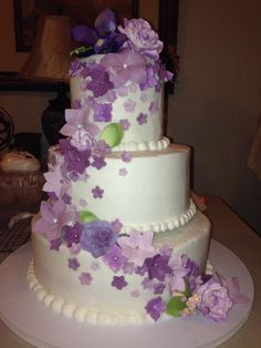 Suzy Zimmermann, Queen of Cake and Events - San Antonio Cakes - Three-tier wedding cake with cascading purple flowers