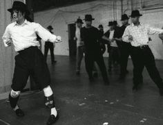 MJJ   Practicing some dance moves---thinking maybe Smooth Criminal because of all the fedora's