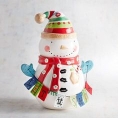 Memories in the making: Our retro-style, hand-painted Snowman Cookie Jar is perfect for homes with kids, former kids and kids-at-heart. He's holding a removable fabric banner that encourages a snowfall, of course. The removable lid fits firmly over a hand-sized opening. But, thankfully, not too firmly.