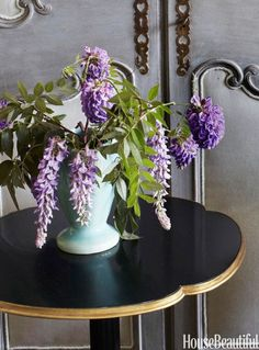 "NATURAL FRAGRANCE – Sweet-smelling lilacs really say ""It's spring!"" — and add a pop of color to this accent table in Kelee Katillac's Kansas City apartment. Click through for the entire gallery and for more spring flowers."