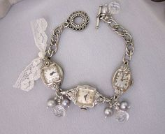 This vintage repurposed watch bracelet features three watches with diamond accents along with pearls and crystal antique buttons -- JryenDesigns -- Layaway is available.     Black Friday / Cyber Monday Special  >>>>>>>>>>>>> FREE SHIPPING - Coupon Code FREESHIP <<<<<<<<<<<<   Coupon Active Thursday (11/22) midnight - Monday (11/26) midnight PST    To view additional one of a kind JRyenDesigns jewelry creations visit my shop here: http://www.etsy.com/shop/jryendesigns?ref=si_shop      This…