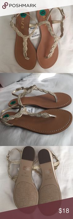 Cute gold sparkly sandals This lovely pair of sandals is new with tags and stickers. They have never been worn before and they are a size 8. Unisa Shoes Sandals