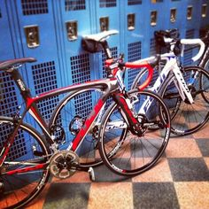 Spotted these @fujibikes SST #roadbikes leaning in the hallway before a photo shoot - they look fast standing still!