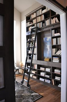 I want a floor to ceiling bookshelf just to have a rolling ladder like this