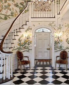 This large staircase and foyer is able to handle a heavily floral wallpaper pattern on the walls thanks to the checkerboard floor and dark stairs Design Entrée, Flur Design, House Design, Design Floral, Design Ideas, Tile Design, Entry Foyer, Entrance Hall, Entryway Stairs