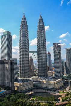 Cocktails with an incredible view of the Petronas Tower at the SkyBar, Traders Hotel, Kuala Lumpur! Read more: http://www.thewholeworldisaplayground.com/cocktails-sky-bar-traders-kuala-lumpur/