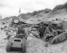 Americns toying around with captured German self-propelled crawler mines 'Goliath' (Sd.Kfz. 302) at Utah beach .