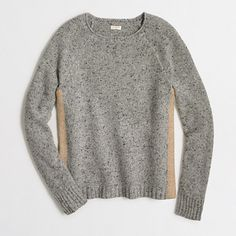 <ul><li>Lambswool/nylon.</li><li>Hits slightly below hip.</li><li>Long sleeves.</li><li>Dry clean.</li><li>Import.</li></ul>