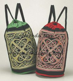 "Printed Celtic cross design red or green cotton backpack bags. Each measures approximately 15"" x 18"". Straps also act as drawstrings for the opening."