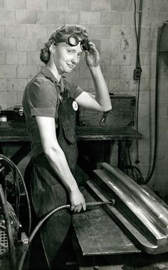 woman grinding a machined part curtiss wright factory___Source.jpg (745×1200)