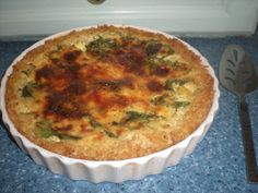 Clean & Lean Quiche with brown rice crust from James Duigan's cook book.  No picture in book but it has come out well and lovely taste. I used spinach, courgettes and peppers as a base with basil and oregano seasoning. Personal preference but next time I would add some tomatoes, onions and a bit more seasoning. Will eat with salad and some beetroot from the allotment this morning .