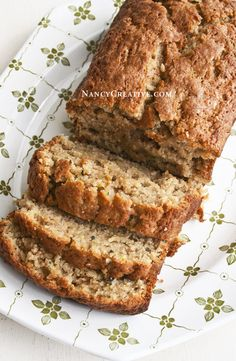 Apple-Zucchini Bread 2 cups all-purpose unbleached flour 1/2 Tablespoon baking soda 1/4 teaspoon salt 1 teaspoon ground cinnamon 1/2 teaspoon ground nutmeg 2 large eggs 3/4 cup light olive oil or non-GMO canola oil 1 cup sugar 1/2 cup packed light brown sugar 1/2 Tablespoon vanilla extract 1 cup shredded unpeeled zucchini 1/2 cup shredded peeled apple (I used a Granny Smith apple) Optional: 3/4 cup chopped pecans or walnuts