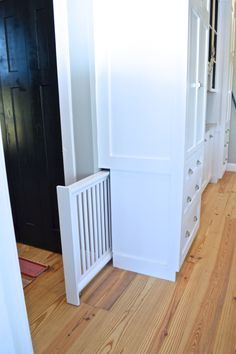 There are a lot of really great advantages to working with a cabinet builder. One of the biggest is customization. In many ways, the sky is the limit. (Assuming you can afford it.) In our case, our… house ideas Built-in hidden dog gate - NewlyWoodwards Home Design, Interior Design, Design Ideas, Design Design, Smart Design, Baby Design, Urban Design, Interior Ideas, Modern Design