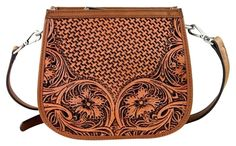 Montana West Lea-6015 Delila 100% Genuine Leather Tooled Collection Brown Cross Body Bag. Get the trendiest Cross Body Bag of the season! The Montana West Lea-6015 Delila 100% Genuine Leather Tooled Collection Brown Cross Body Bag is a top 10 member favorite on Tradesy. Save on yours before they are sold out!