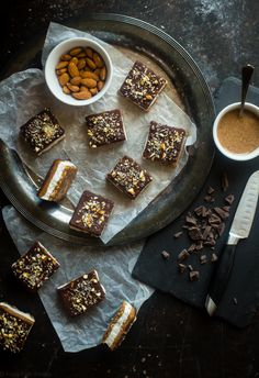No-Bake Paleo Salted Almond Joy Bars - These salty-sweet, SUPER easy, no-bake bars taste like a frozen Almond Joy! They're the perfect healthy summer treat that's paleo and vegan friendly!   Foodfaithfitness.com   @FoodFaithFit
