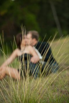 Engagement Photography like this but maybe with a flower or peeking around a tree instead of grass?