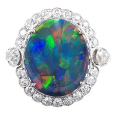 Lightning Ridge Black Opal & Diamond French Ring | From a unique collection of vintage cluster rings at https://www.1stdibs.com/jewelry/rings/cluster-rings/