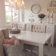 I love the colours and just the right amount of decorating.  The chandelier is the focal point!