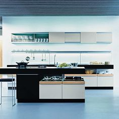 Kitchen cabinets from German manufacturer Poggenpohl. The island contains the cooktop glass-ceramic and bar with a wide top. Modern Kitchen Cabinets, Kitchen Cabinet Design, Kitchen Interior, Kitchen Island With Cooktop, Island Cooktop, Black Kitchens, Luxury Kitchens, European Furniture, Luxury Furniture