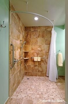 Great example of a roll-in shower. The grab bars are appropriately placed for safety and stability. A shower chair and bench can easily be added to the stall. The curved shower rod increases the shower space Ada Bathroom, Handicap Bathroom, Bathroom Renos, Basement Bathroom, Modern Bathroom, Small Bathroom, Bathroom Plans, Bathroom Ideas, Shower Remodel