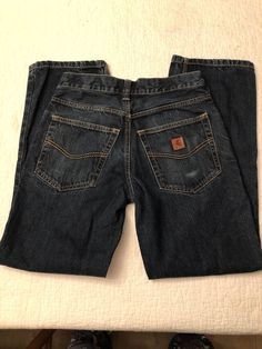 6e10e3e1 You're viewing a Preowned men's pair of carhartt traditional fit blue jeans  size 29 x No rips or holes and comes from a smoke free home.