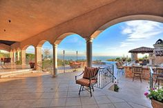 Villa Mara Malibu 4,000 square feet of ocean views, cabanas, an outdoor kitchen, a double infinity pool, 24 seat fire pit, movie theater, fountains, and communal dining setting is the ideal Malibu location Weddings or Events in Los Angeles | LA Spice Catering